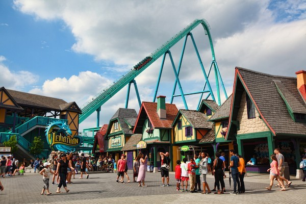 Vaughan, Ontario, Canada - July 26, 2014: People enjoying the summer time outdoors by spending time at Canada's Wonderland amusement park and riding the tallest and fastest roller coaster in Canada - the Leviathan. Taken in July 2014.